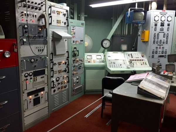 Inside the control room, the following items, now considered relics, helped keep the world from nuclear disaster: grease pencils, rotary phones, analog clocks, slide rules, printed manuals, and ASCII tape. Quaint.
