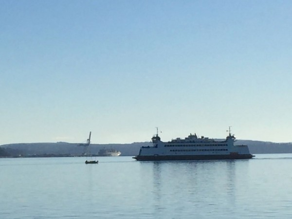 Sea Scouts on the left, appearing to take on a Washington State Ferry.
