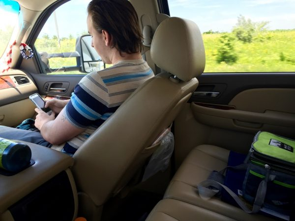 This is our life now. He with the longest legs rides shotgun, which means the non-driver gets half the back seat. Question of the Summer: Will we let him drive?