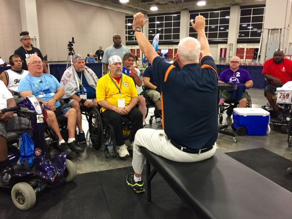 Here he's explaining proper technique to the athletes. Rules had changed from the year before, so it was essential that everyone understood the new procedure.