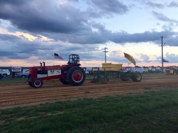 And I don't mean to brag, but... fence-side at the tractor pull, baby!