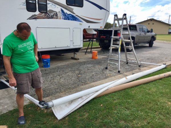 Got it to the ground, and now we unroll it and slide it off.