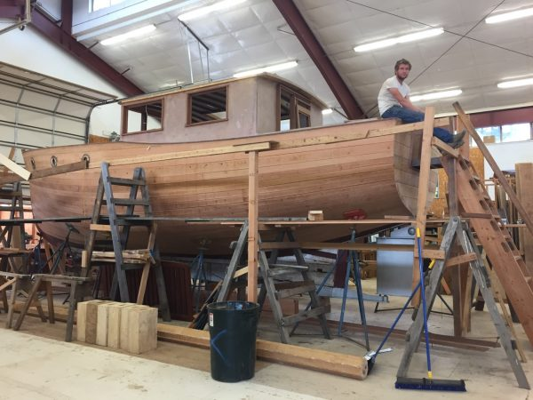 That's him, sitting up there on the Chamberlain, a craft he's done a lot of work on during his time at the boat school.