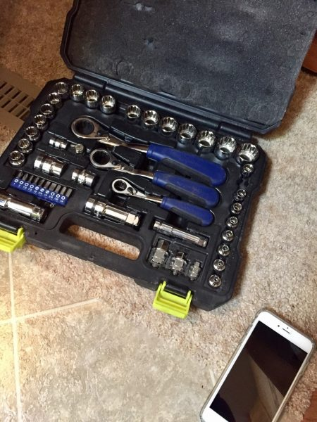Critical tools: socket wrench set, and an iPhone (which served conveniently as both a flashlight and an internet reference guide)